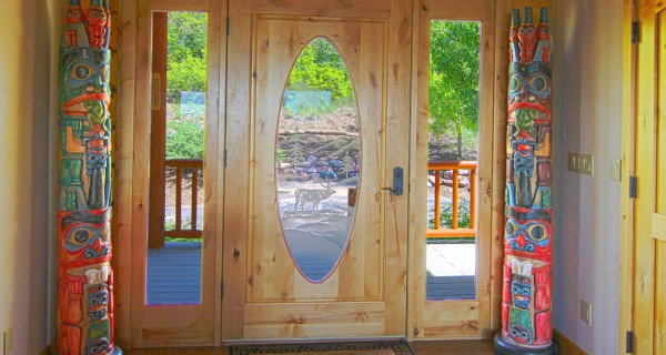 9448 CR 502 custom front door with totem poles